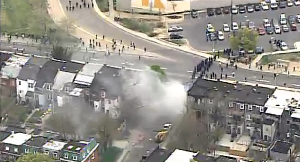 Baltimore riot police deploy smoke canisters to ward off angry protesters.
