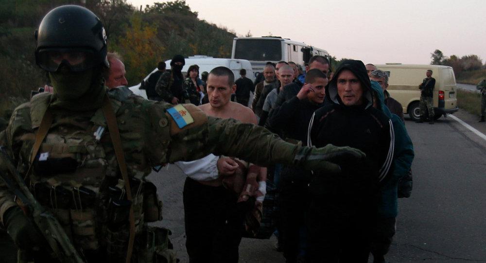 Ukraine, rebels exchange prisoners
