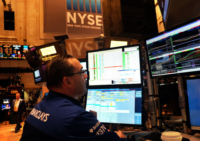 A trader works on the floor of the New York Stock Exchange (NYSE) on February 6, 2015