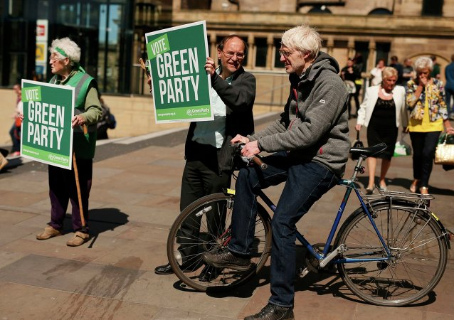 Green Party supporters hold posters during a speech by party leader Natalie Bennett at a campaign event in Liverpool northern England, April 26 , 2015