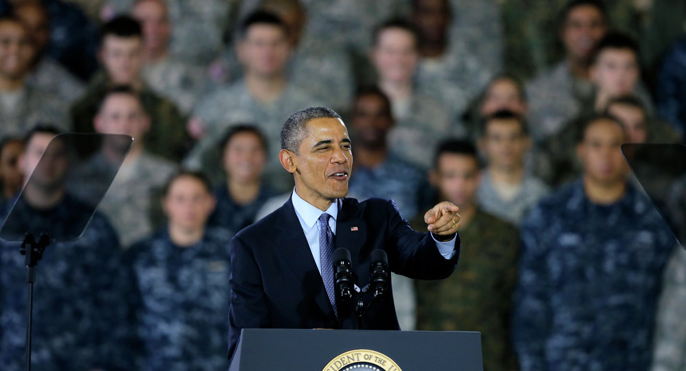 President Barack Obama speaks to military members and families Monday, Dec. 15, 2014, at Joint Base McGuire-Dix-Lakehurst, in Wrightstown, N.J.