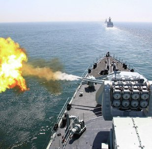 In this April 26, 2012 file photo released by China's Xinhua News Agency, Chinese navy's missile destroyer DDG-112 Harbin fires a shell during the China-Russia joint naval exercise in the Yellow Sea