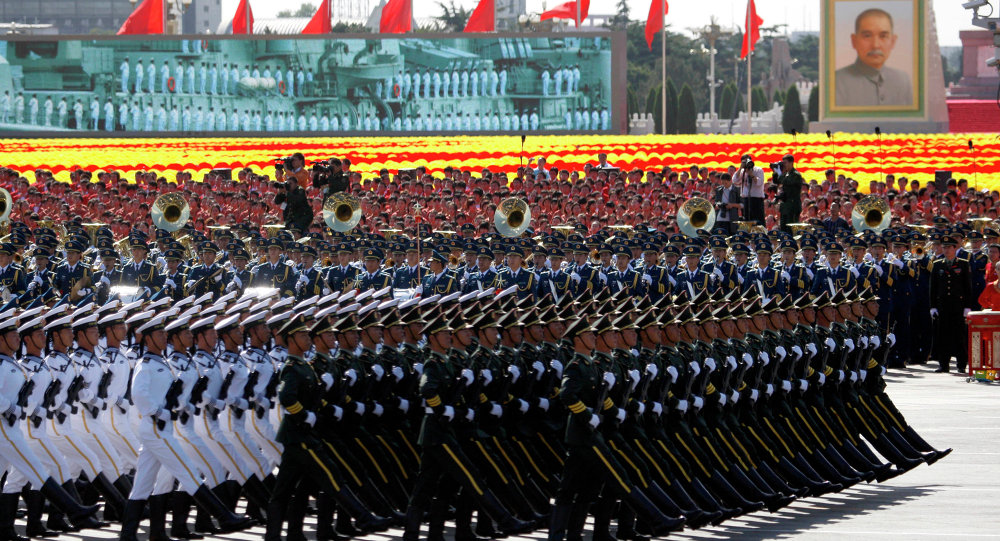 Chinese soldiers march during a military parade to mark the 60th anniversary of China in Beijing Thursday, Oct. 1, 2009.