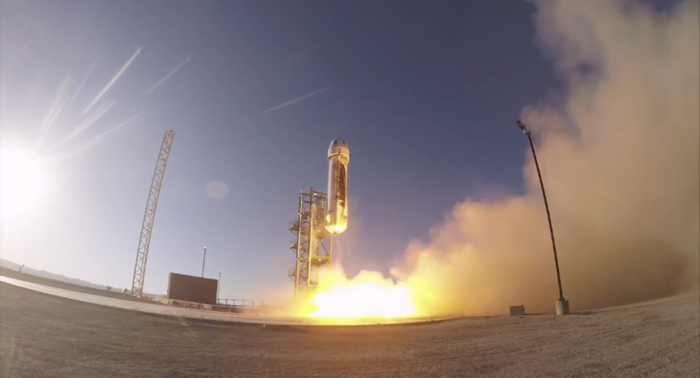 Jeff Bezos test-launches a suborbital rocket.