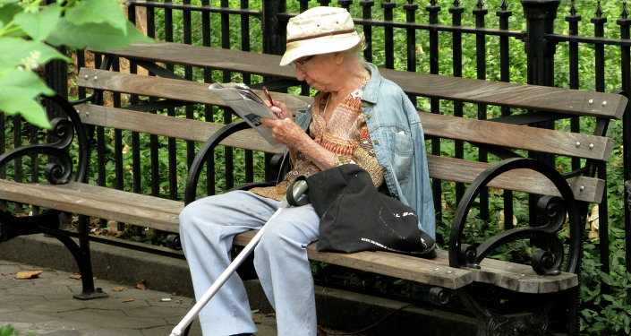 Elderly Woman Reading in New York City.