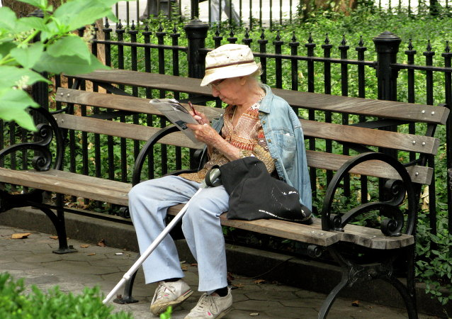 Elderly Woman Reading in New York City
