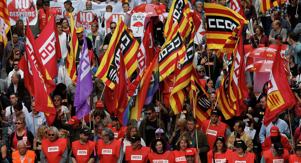 People protest during a May Day rally in the center of Barcelona, Spain, Friday, May 1, 2015