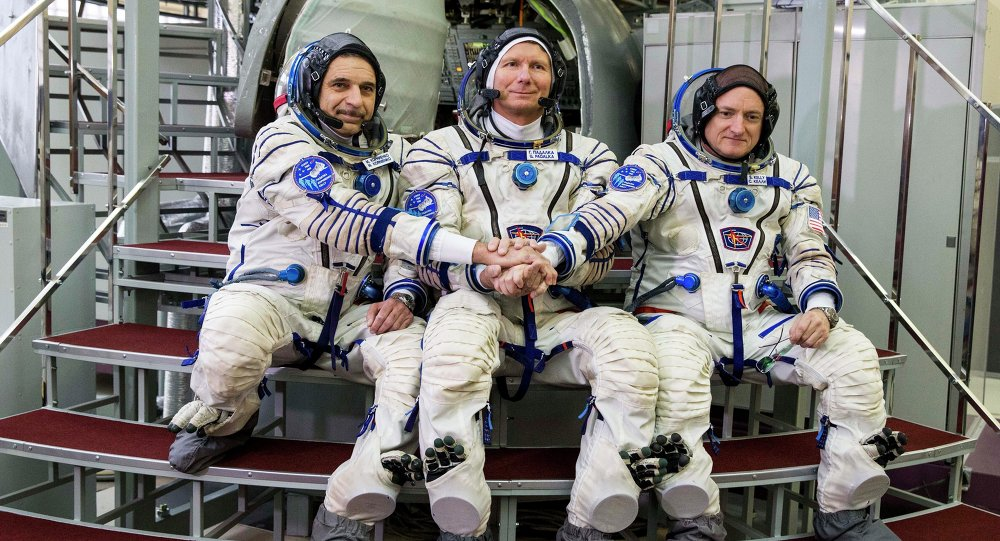 US astronaut Scott Kelly, right, Russian cosmonauts Gennady Padalka, center, and Mikhail Korniyenko pose before their final preflight practical examination