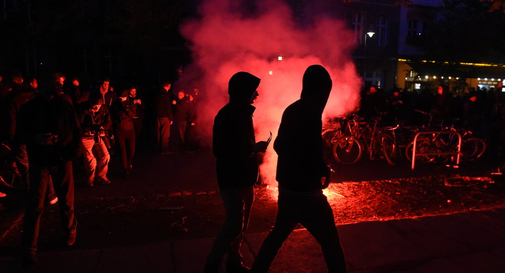 Flares are lit during the 'Revolutionary' May Day demonstration in Berlin on May 1, 2015.
