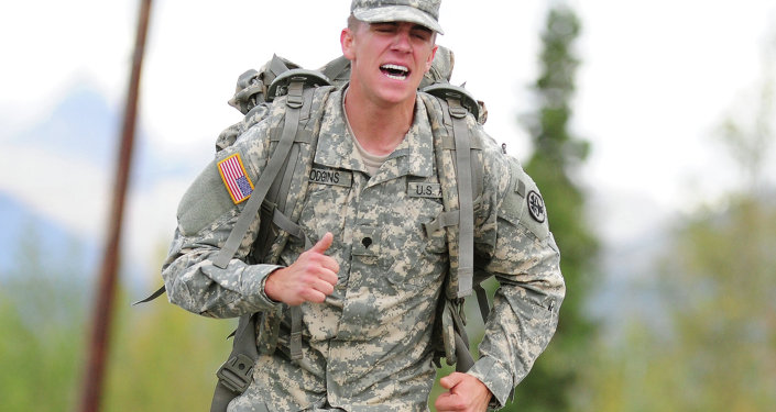 Soldiers compete in a Combat Cross-Country Series, 10-Mile Relay on the Davis Highway