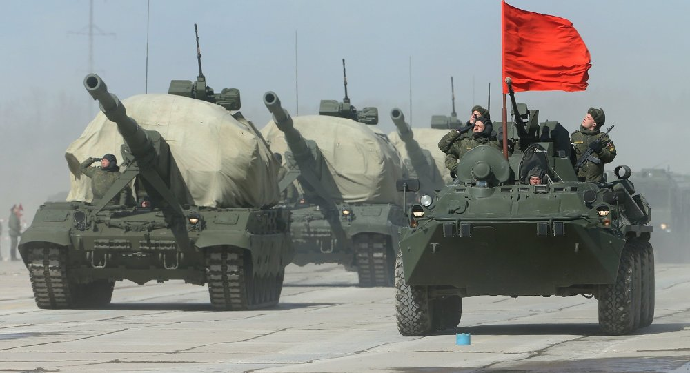 A Koalitsia-SV self-propelled gun, left, and a BTR-82A armored personnel carrier during the rehearsal of the Victory Day Parade in the Moscow Region