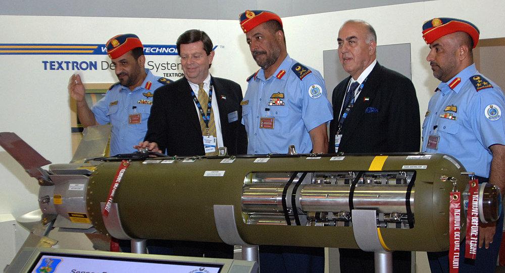 Thomas Harrington, vice president of US Textron Defense Systems, (2nd L) presents a sensor fuzed weapon CBU-105 to Emirati Major General Mohammed bin Swaidan Said al-Qamzi, Commander of UAE's Air Force and Air Defence, (3rd L)