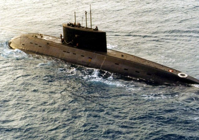 A Russian-built, Kilo-class diesel submarine recently purchased by Iran, is towed by a support vessel in this photograph taken in the central Mediterranean Sea