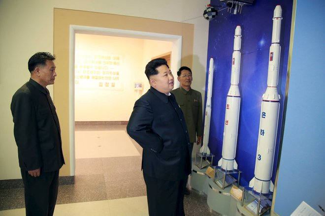North Korean leader Kim Jong Un (C) provides field guidance at the newly built National Space Development General Satellite Control and Command Centre in this undated photo released by North Korea's Korean Central News Agency (KCNA) in Pyongyang May 3, 2015.