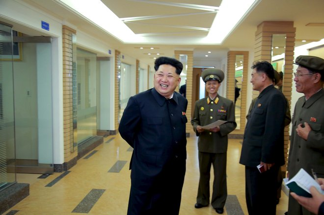 North Korean leader Kim Jong Un (L) provides field guidance at the newly built National Space Development General Satellite Control and Command Centre in this undated photo released by North Korea's Korean Central News Agency (KCNA) in Pyongyang May 3, 2015.
