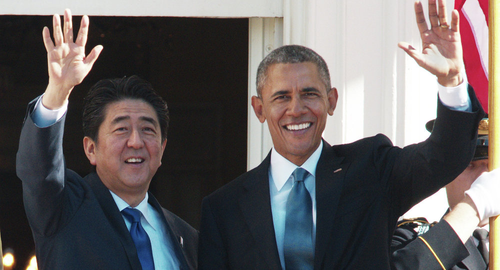 US President Barack Obama and Japan's Prime Minister Shinzo Abe wave during the official welcome ceremony on the South Lawn of the White House on April 28, 2015 in Washington, DC.