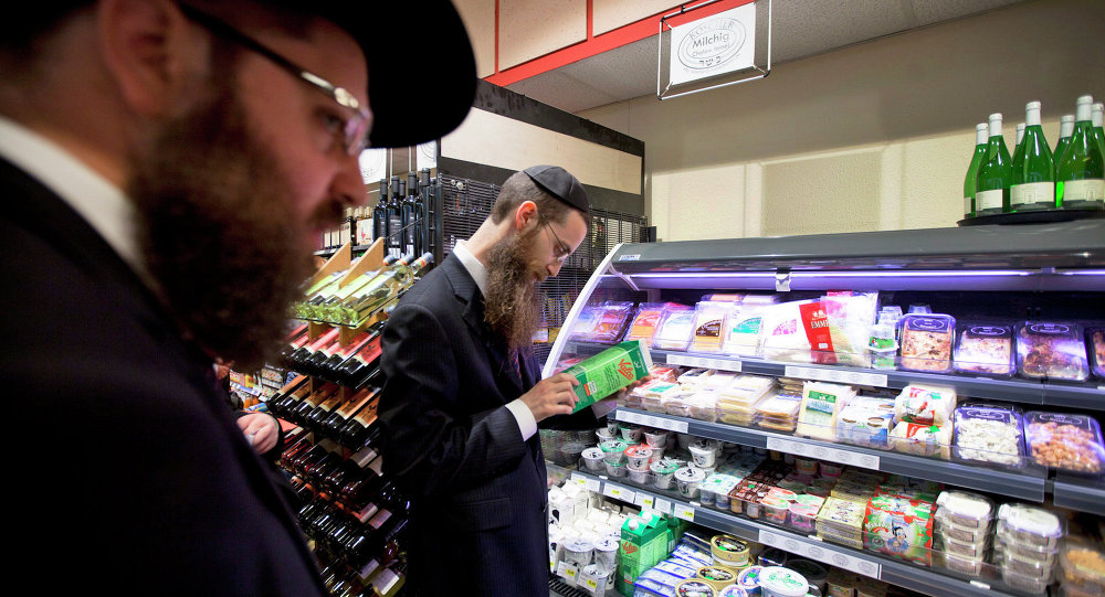 Orthodox Jewish men check kosher food at a supermarket in Berlin