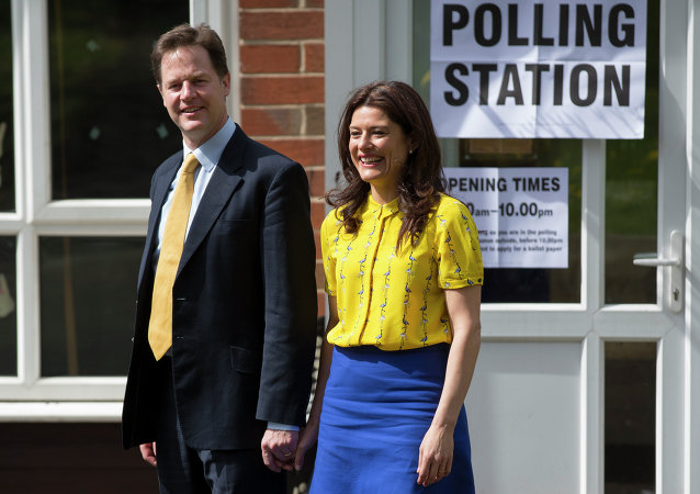 Liberal Democrat Party leader Nick Clegg and his wife Miriam Gonzalez Durantez leave the the Hall Park Centre after voting in Sheffield, England, Thursday May 7, 2015