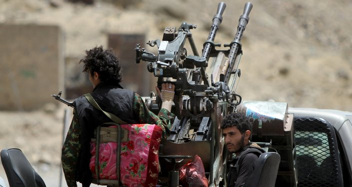Houthi militants ride in a patrol truck in Sanaa May 2, 2015