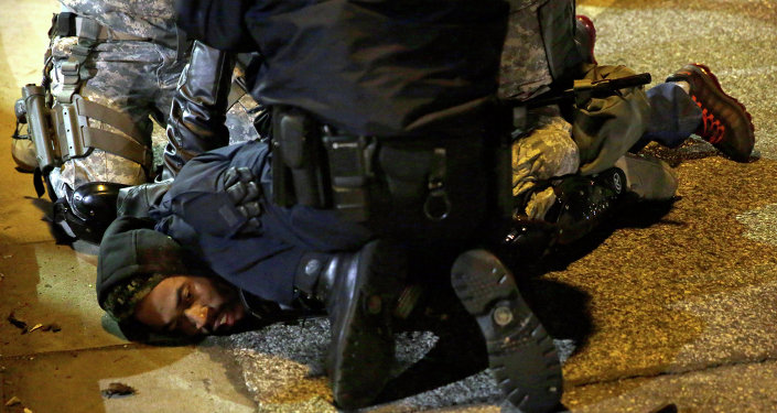 A protester is taken into custody in Ferguson.