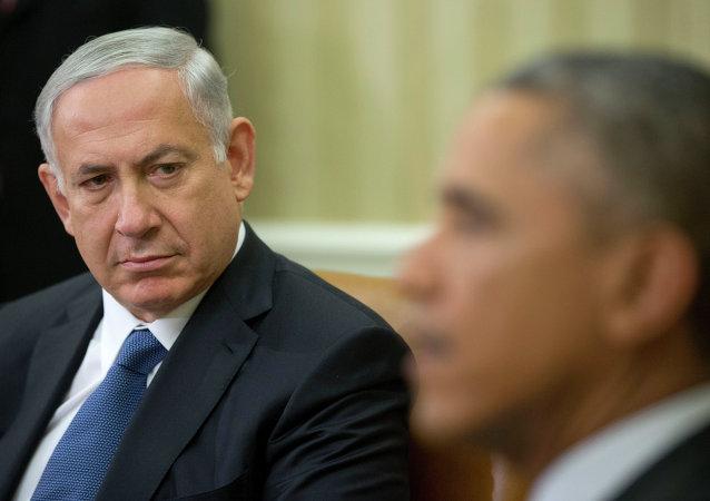 Israeli Prime Minister Benjamin Netanyahu listens as President Barack Obama speaks during their meeting in the Oval Office of the White House in Washington, Wednesday, Oct. 1, 2014.