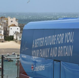 Conservative Party election campaign bus stands parked in St Ives, south-west England on May 5, 2015