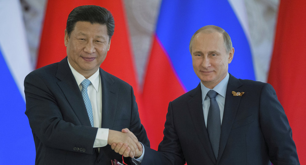 Russian President Vladimir Putin meets with Chinese President Xi Jinping