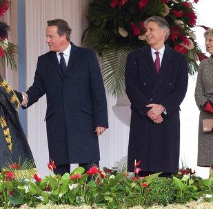 British Prime Minister David Cameron (2L), Foreign Secretary Philip Hammond (C) and Home Secretary Theresa May (R)