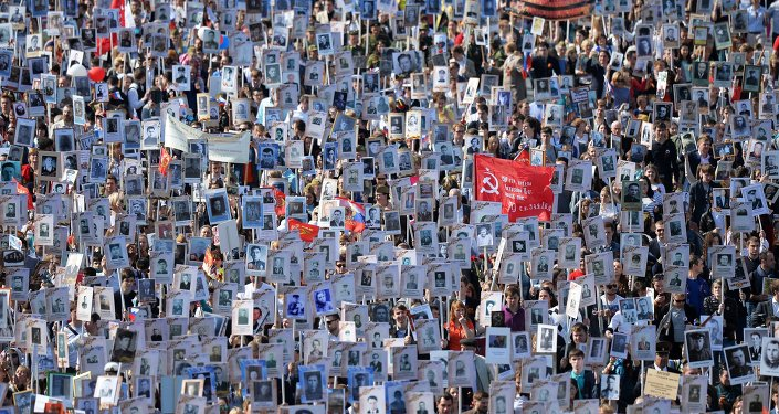 Participants of procession of Regional patriotic public organization Immortal Regiment Moscow along the Red Square