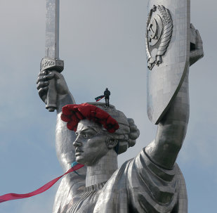 Kiev's Motherland Monument in Kiev. Feeling sheepish about removing the 102-meter tall Soviet-era monument overlooking the capital, authorities decided to decorate it with a wreath of poppies and a ribbon instead.