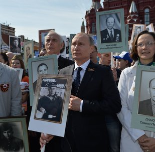 Russian President Vladimir Putin participates in march of Immortal Regiment in downtown Moscow
