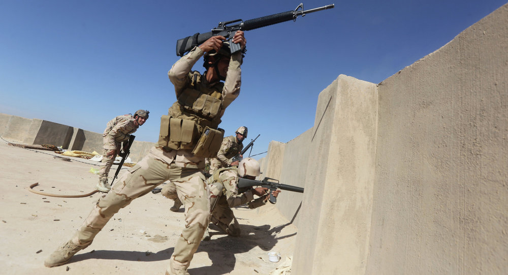 Iraqi soldiers fire their weapons towards Islamic State (IS) group positions