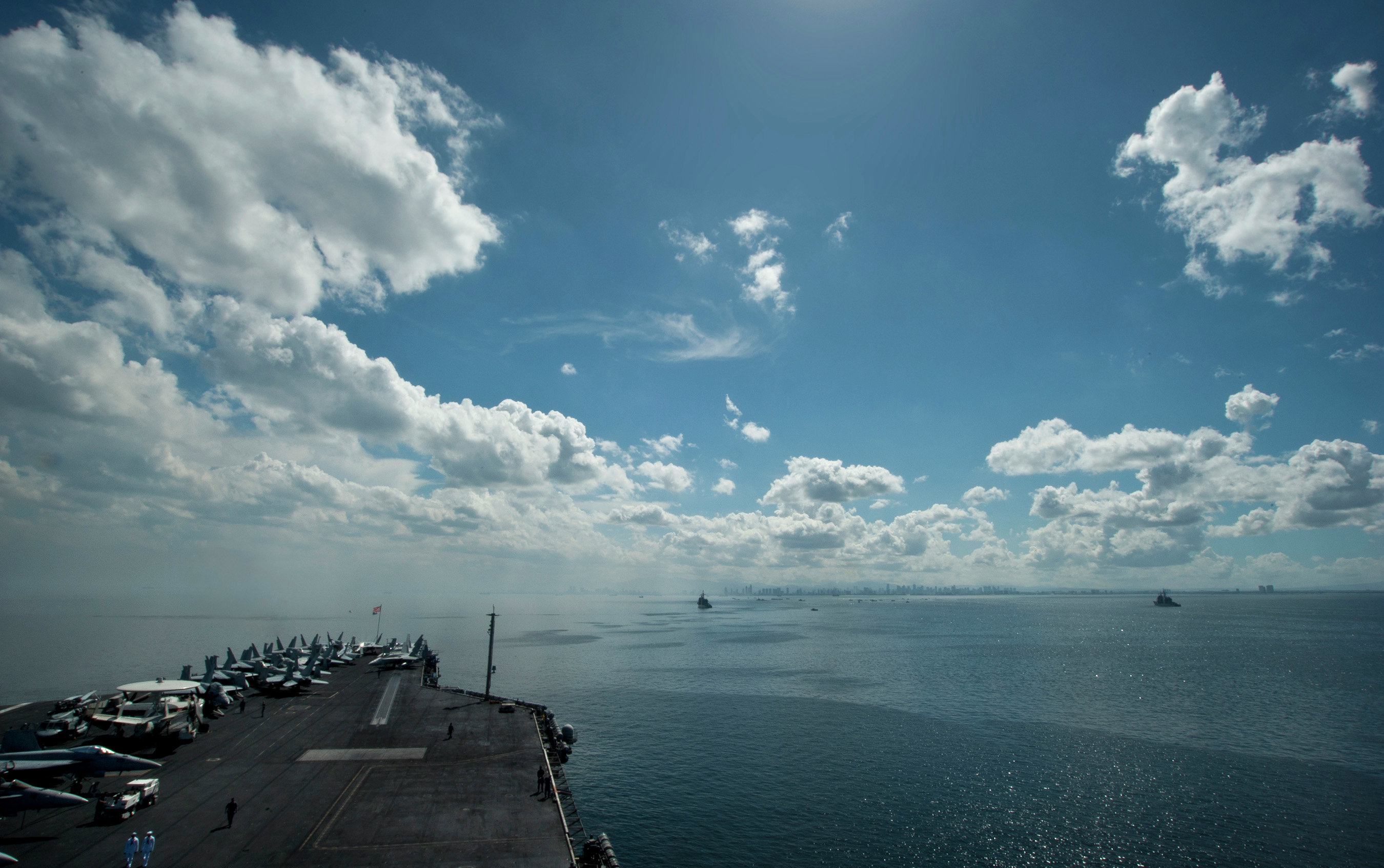 USS Carl Vinson (CVN 70) and ships from the Carl Vinson Carrier Strike Group anchor in Manila Bay.
