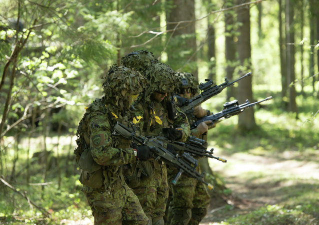 Estonian soldiers take part in an annual military exercise together with several units from other NATO member states