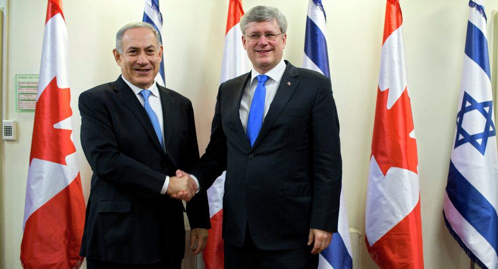 Israeli Prime Minister Benjamin Netanyahu, left, and Canadian Prime Minister Stephen Harper shake hands.