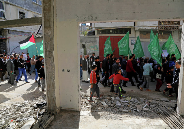 Palestinian Hamas supporters march with green Hamas and national flags in Beit Hanoun, northern Gaza Strip.