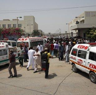 Ambulances and people gather gather outside the hospital