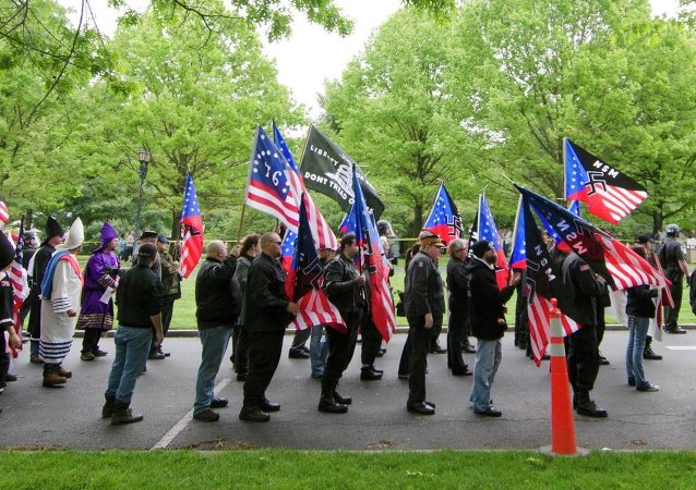 Members of the National Socialists Movement and the White Knights of the Klu Klux Klan begin a march to the Capitol in Frankfort, Ky