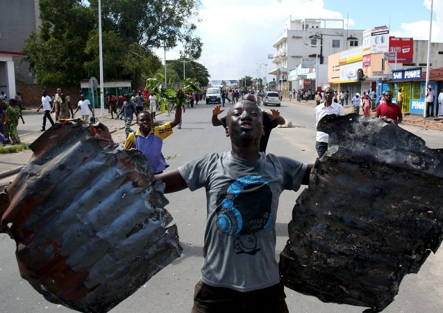 A man celebrates in a street in Bujumbura, Burundi, May 13, 2015