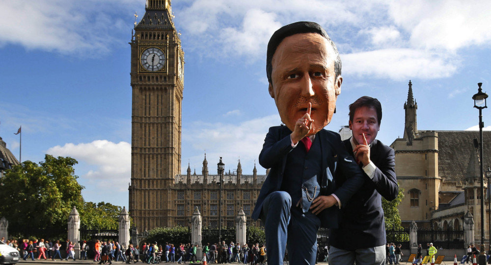 Free speech campaigners, one wearing a mask depicting British Prime Minister David Cameron, left, and another wearing a mask depicting ex-LibDem leader Nick Clegg, stage a photo op for the media during a protest opposite from the Houses of Parliament in central London in 2013.