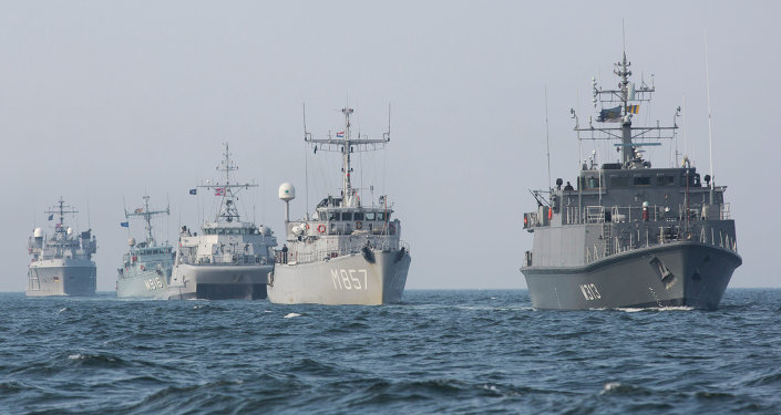 From left, Norwegian support vessel Valkyrien, Belgian mine-hunter Belis, Norwegian minesweeper Otra, Dutch mine-hunter Makkum and Estonian mine-hunter Admiral Cowen form a convoy during a NATO deployment in the Baltic Sea along the German Coast, Tuesday, April 22, 2014