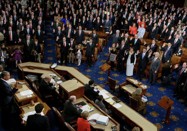 Speaker of the House John Boehner(L),R-OH, swears in members of the House during a ceremony in the House of Representatives as the 114th Congress convenes on Capitol Hill January 6, 2015 in Washington