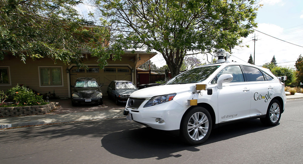 Google's self-driving Lexus car drives along street during a demonstration at Google campus on Wednesday, May 13, 2015, in Mountain View, Calif