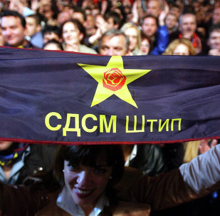 Supporters of the Social Democratic Union of Macedonia (SDSM) with party symbols