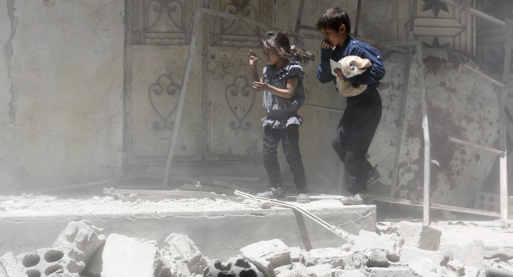 Children walk over rubble carrying a bag of bread after what activists said were airstrikes by warplanes loyal to Syria's President Bashar al-Assad in Erbeen, in the eastern Damascus suburb of Ghouta May 15, 2015