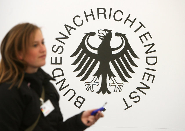 A guest walks past a logo of Germany's intelligence agency the Bundesnachrichtendienst (BND - Federal Intelligence Service)