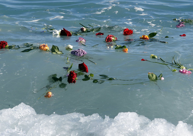 A file photo showing flowers float in the sea after they were thrown into the Mediterranean in honor of the migrants lost making the perilous journey across the sea, on April 28, 2015 in Nice, southeastern France