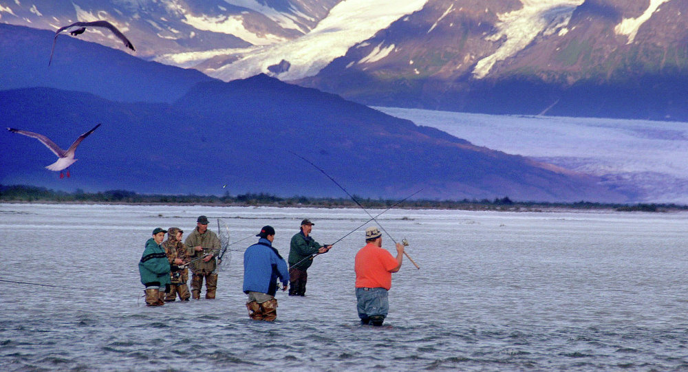 A group of fishermen gather along the Knik River near Palmer, Alaska