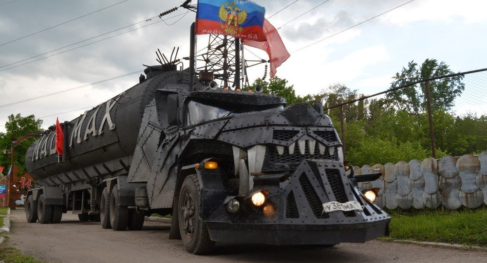 Mad Max arriving in Lugansk, flying the flag of the self-proclaimed Lugansk People's Republic.