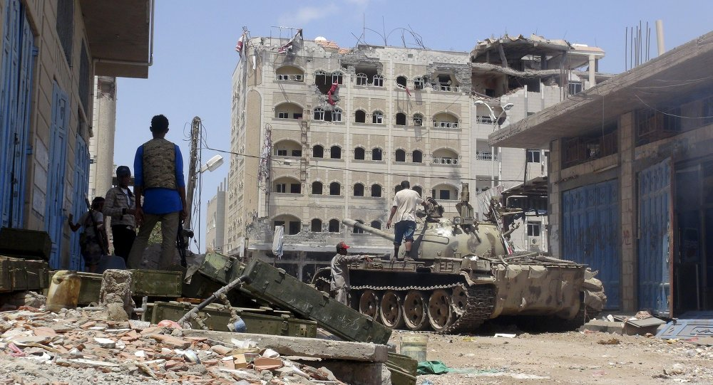Anti-Houthi fighters of the Southern Popular Resistance stand near a tank in Yemen's southern port city of Aden May 16, 2015